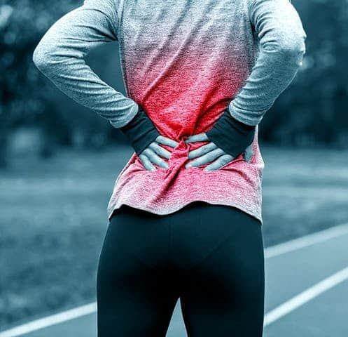 woman athlete with back pain