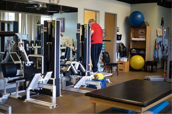 man completing physical therapy treatment at pain care of san diego